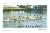 tc jpn kansai univ. rowing 8 crew in white boat on canal