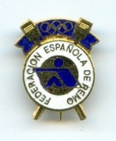 pin esp rowing federation pictogram in blue crossed golden oars with olympic rings